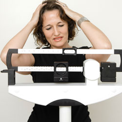 woman disappointed at weight loss image